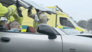 Fire brigade removing roof from car as part of our Modern Slavery Campaign video